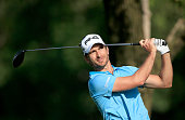 Alejandro Canizares of Spain plays his tee shot at the par 4 fifth hole during the first round of the 2016 Omega Dubai Desert Classic on the Majlis...