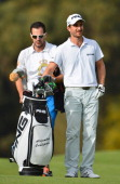 Alejandro Canizares of Spain ponders with his caddie during the third round of the Trophee Hassan II Golf at Golf du Palais Royal on March 15 2014 in...