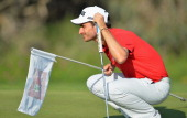 Alejandro Canizares of Spain prepares to putt during the second round of the Trophee Hassan II Golf at Golf du Palais Royal on March 14 2014 in...