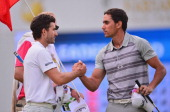 Alejandro Canizares of Spain shakes hands with Rafael Cabrera Bello of Spain during the third round of the Trophee Hassan II Golf at Golf du Palais...