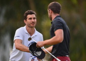 Alejandro Canizares of Spain shakes hands with Seve Benson of England during the third round of the Trophee Hassan II Golf at Golf du Palais Royal on...