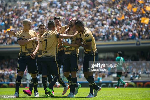 Alejandro Castro of Pumas celebrates with his teammates after scoring the opening goal during a 1st round match between Pumas UNAM and Monterrey as...
