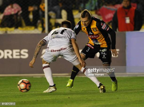 Alejandro Chumacero of The Strongest and Gabriel Carrasco of Lanus fight for the ball during a first leg match between The Strongest and Lanus as...