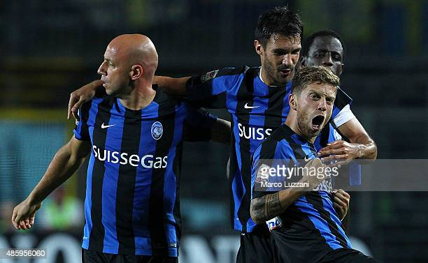 Alejandro Dario Gomez of Atalanta BC celebrates his goal with his teammates Nicolo Cherubin and Giulio Migliaccio during the Serie A match between...