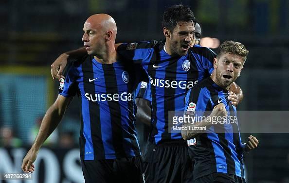 Alejandro Dario Gomez of Atalanta BC celebrates his goal with his teammates Nicolo Cherubin and Giulio Migliaccio during the Serie A match between...