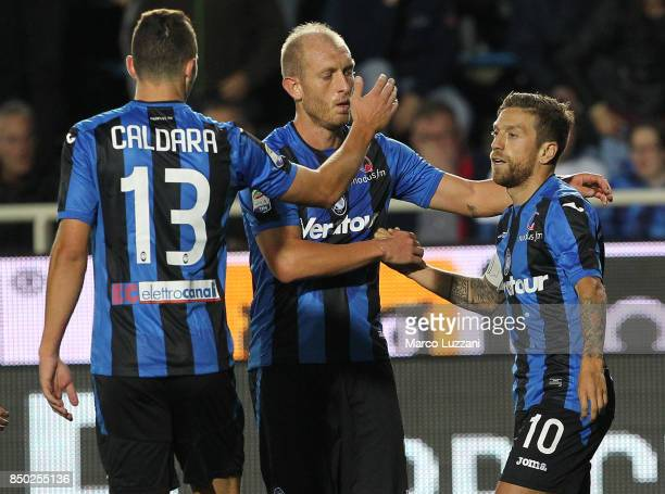 Alejandro Dario Gomez of Atalanta BC celebrates his goal with his teammates Andrea Masiello and Mattia Caldara during the Serie A match between...