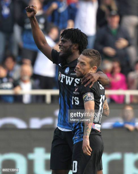 Alejandro Dario Gomez of Atalanta BC celebrates with his teammate Franck Kessie after scoring his second goal during the Serie A match between...