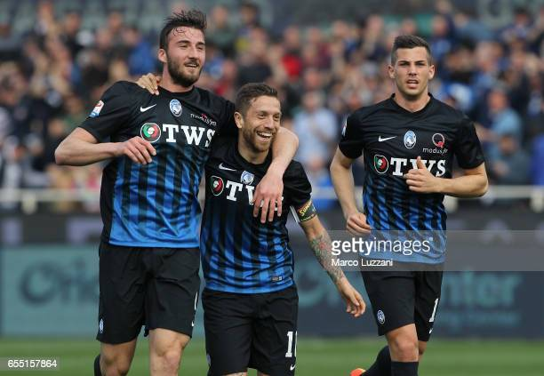 Alejandro Dario Gomez of Atalanta BC celebrates with his teammates Bryan Cristante and Remo Freuler after scoring the opening goal during the Serie A...