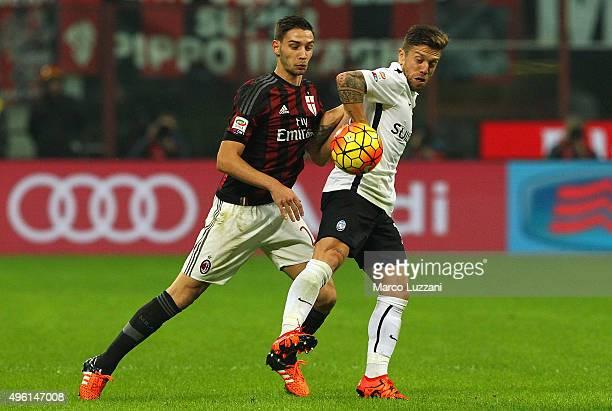Alejandro Dario Gomez of Atalanta BC competes for the ball with Mattia De Sciglio of AC Milan during the Serie A match between AC Milan and Atalanta...