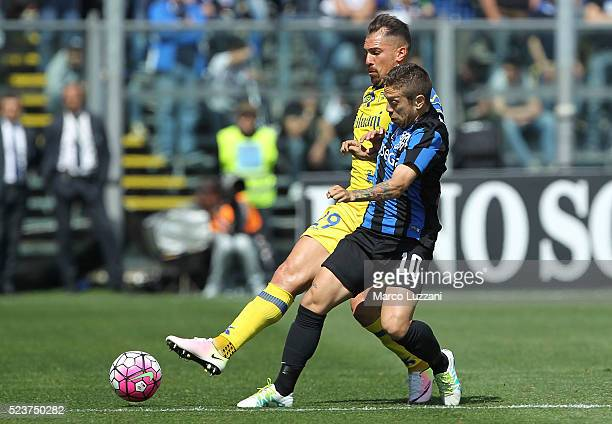 Alejandro Dario Gomez of Atalanta BC competes for the ball with Fabrizio Cacciatore of AC Chievo Verona during the Serie A match between Atalanta BC...