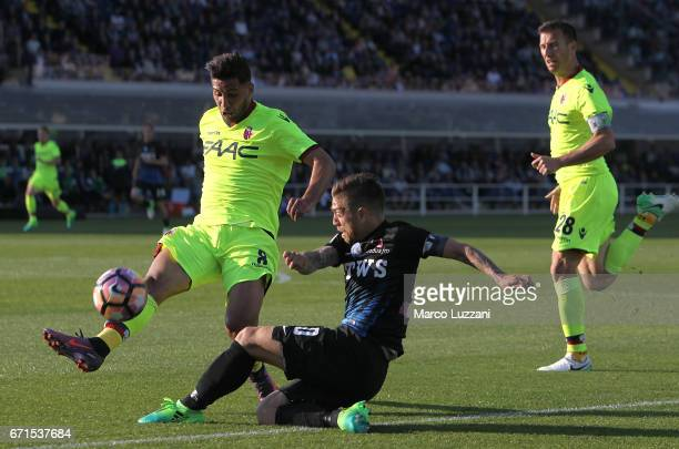 Alejandro Dario Gomez of Atalanta BC competes for the ball with Saphir Sliti Taider of Bologna FC during the Serie A match between Atalanta BC and...