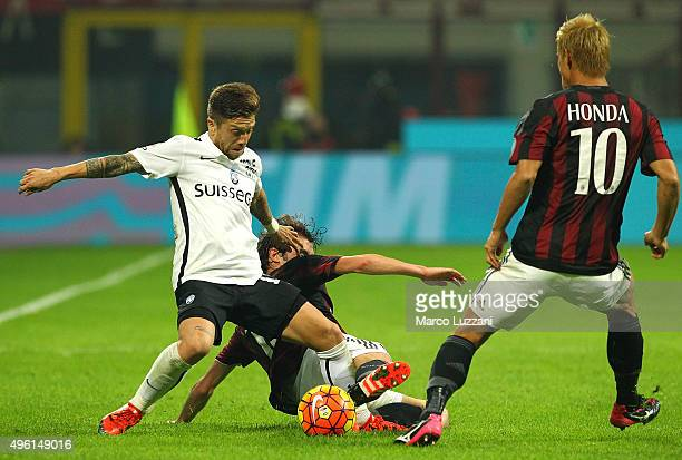 Alejandro Dario Gomez of Atalanta BC competes for the ball with Andrea Poli and Keisuke Honda of AC Milan during the Serie A match between AC Milan...