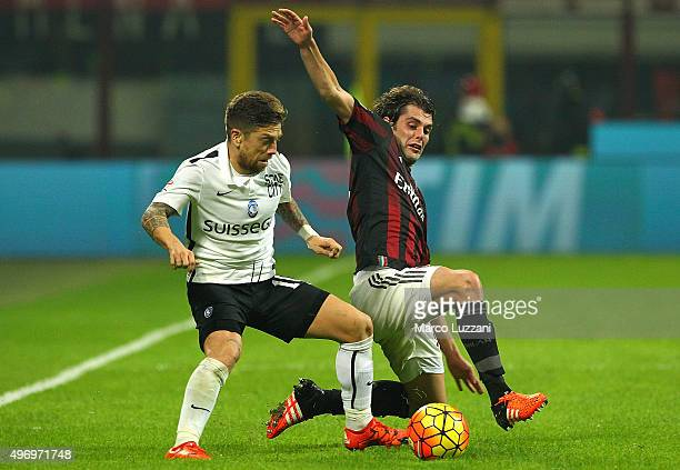 Alejandro Dario Gomez of Atalanta BC competes for the ball with Andrea Poli of AC Milan during the Serie A match between AC Milan and Atalanta BC at...