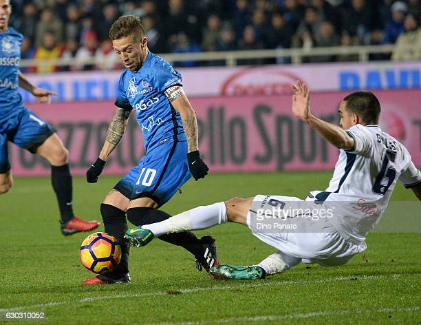 Alejandro Dario Gomez of Atalanta BC competes with Giuseppe Belusci of Empoli FC during the Serie A match between Atalanta BC and Empoli FC at Stadio...