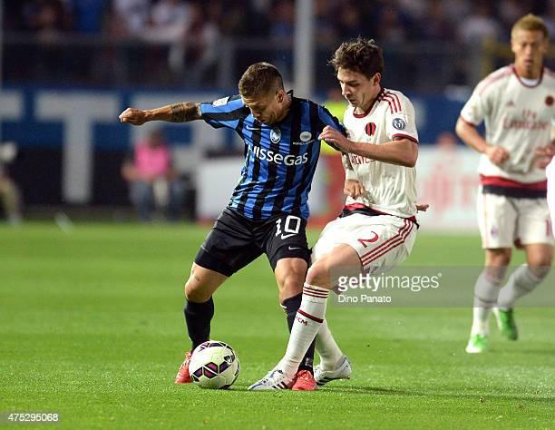 Alejandro Dario Gomez of Atalanta BC competes with Mattia De Sciglio of AC Milan during the Serie A match between Atalanta BC and AC Milan at Stadio...