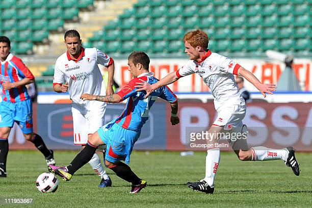 Alejandro Dario Gomez of Catania and Alessandro Gazzi of Bari in action during the Serie A match between AS Bari and Catania Calcio at Stadio San...
