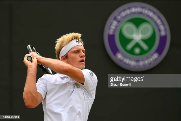 Alejandro Davidovich Fokina of Spain plays a backhand during the Boys' Singles final match against Axel Geller of Argentinaon day thirteen of the...