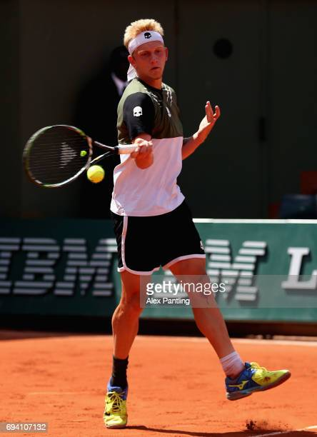 Alejandro Davidovich Fokina of Spain plays a forehand during boys singles semifinal match against Alexei Popyrin of Australia on day thirteen of the...