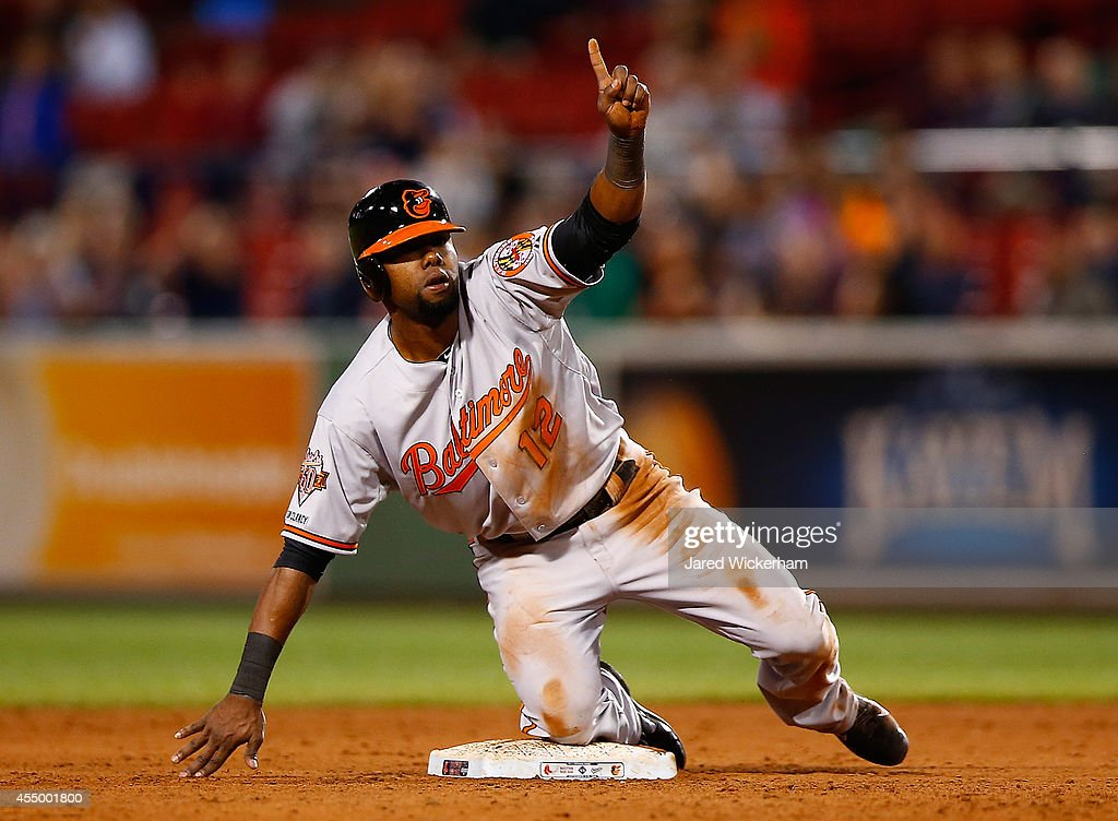 <a gi-track='captionPersonalityLinkClicked' href=/galleries/search?phrase=Alejandro+De+Aza&family=editorial&specificpeople=4181650 ng-click='$event.stopPropagation()'>Alejandro De Aza</a> of the Baltimore Orioles argues a double play call from second base against the Boston Red Sox during the game at Fenway Park on September 8, 2014 in Boston, Massachusetts.