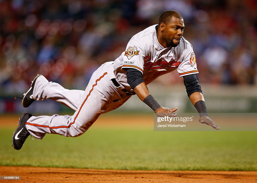 <a gi-track='captionPersonalityLinkClicked' href=/galleries/search?phrase=Alejandro+De+Aza&family=editorial&specificpeople=4181650 ng-click='$event.stopPropagation()'>Alejandro De Aza</a> of the Baltimore Orioles jumps and slides safely into third base against the Boston Red Sox during the game at Fenway Park on September 8, 2014 in Boston, Massachusetts.