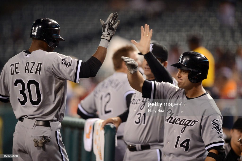 <a gi-track='captionPersonalityLinkClicked' href=/galleries/search?phrase=Alejandro+De+Aza&family=editorial&specificpeople=4181650 ng-click='$event.stopPropagation()'>Alejandro De Aza</a> #30 of the Chicago White Sox celebrates his homerun with <a gi-track='captionPersonalityLinkClicked' href=/galleries/search?phrase=Paul+Konerko&family=editorial&specificpeople=203327 ng-click='$event.stopPropagation()'>Paul Konerko</a> #14 for a 1-0 lead over the Los Angeles Angels at Angel Stadium of Anaheim on September 21, 2012 in Anaheim, California.