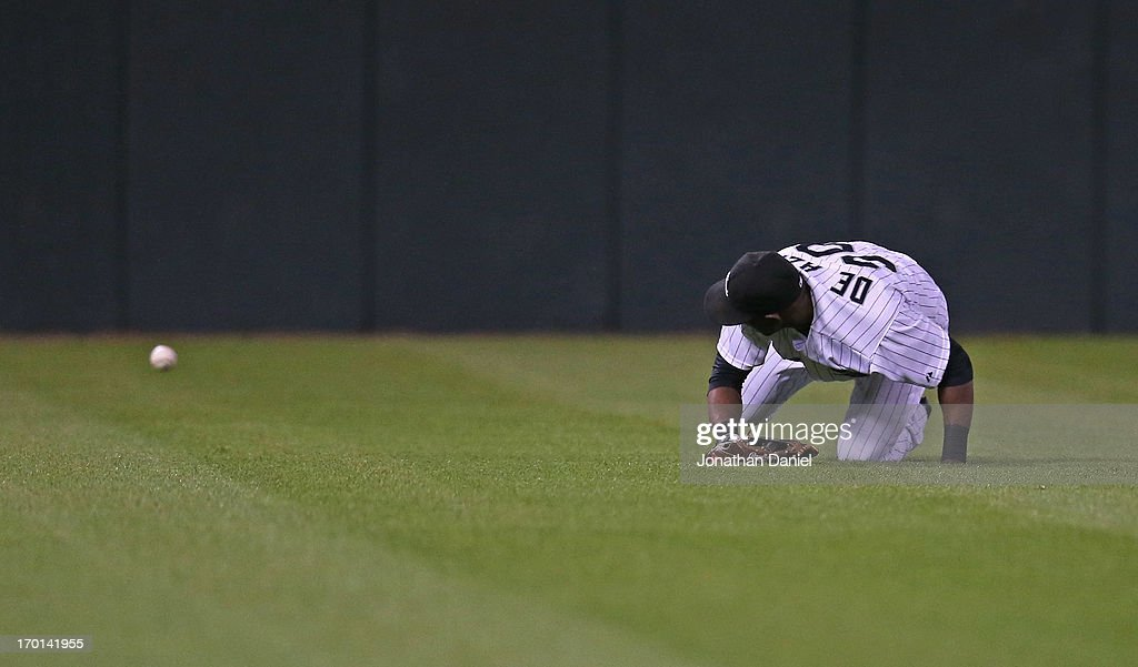 <a gi-track='captionPersonalityLinkClicked' href=/galleries/search?phrase=Alejandro+De+Aza&family=editorial&specificpeople=4181650 ng-click='$event.stopPropagation()'>Alejandro De Aza</a> #30 of the Chicago White Sox commits a fielding error in the 6th inning against the Oakland Athletics at U.S. Cellular Field on June 7, 2013 in Chicago, Illinois.