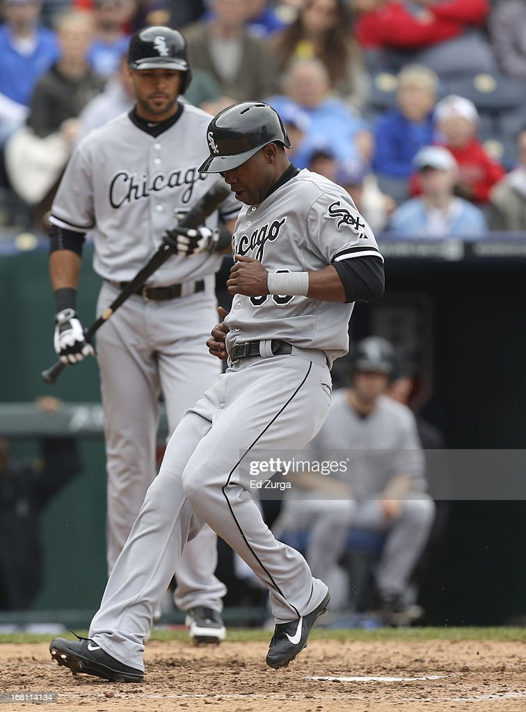 Alejandro De Aza #30 of the Chicago White Sox crosses home as he scores on a wild pitch by Aaron Crow of the Kansas City Royals in the seventh inning at Kauffman Stadium on May 5, 2013 in Kansas City, Missouri.