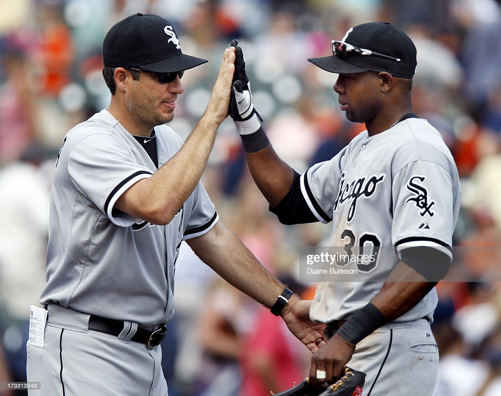 <a gi-track='captionPersonalityLinkClicked' href=/galleries/search?phrase=Alejandro+De+Aza&family=editorial&specificpeople=4181650 ng-click='$event.stopPropagation()'>Alejandro De Aza</a> #30 of the Chicago White Sox gets a high-five from manager <a gi-track='captionPersonalityLinkClicked' href=/galleries/search?phrase=Robin+Ventura&family=editorial&specificpeople=211486 ng-click='$event.stopPropagation()'>Robin Ventura</a> #23 after a 6-3 win over the Detroit Tigers at Comerica Park on July 11, 2013 in Detroit, Michigan.
