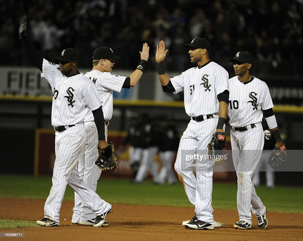 <a gi-track='captionPersonalityLinkClicked' href=/galleries/search?phrase=Alejandro+De+Aza&family=editorial&specificpeople=4181650 ng-click='$event.stopPropagation()'>Alejandro De Aza</a> #30 of the Chicago White Sox, <a gi-track='captionPersonalityLinkClicked' href=/galleries/search?phrase=Gordon+Beckham&family=editorial&specificpeople=5411079 ng-click='$event.stopPropagation()'>Gordon Beckham</a> #15, <a gi-track='captionPersonalityLinkClicked' href=/galleries/search?phrase=Alex+Rios&family=editorial&specificpeople=224676 ng-click='$event.stopPropagation()'>Alex Rios</a> #51 and <a gi-track='captionPersonalityLinkClicked' href=/galleries/search?phrase=Alexei+Ramirez&family=editorial&specificpeople=690568 ng-click='$event.stopPropagation()'>Alexei Ramirez</a> #10 celebrate the Chicago White Sox victory over the Tampa Bay Rays on September 28, 2012 at U.S. Cellular Field in Chicago, Illinois. The Chicago White Sox defeated the Tampa Bay Rays 3-1.