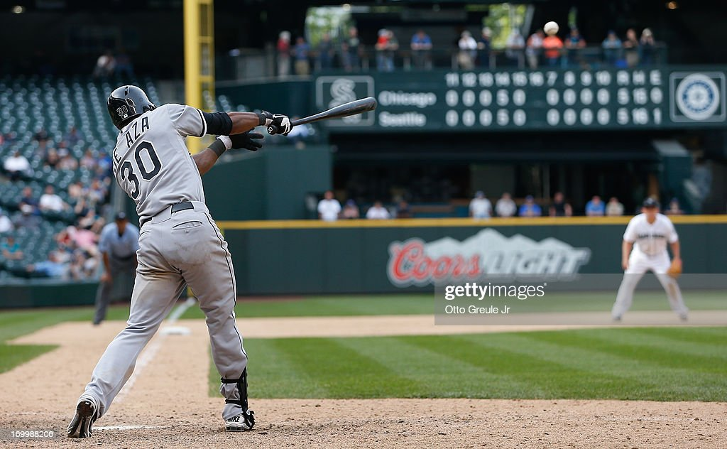 <a gi-track='captionPersonalityLinkClicked' href=/galleries/search?phrase=Alejandro+De+Aza&family=editorial&specificpeople=4181650 ng-click='$event.stopPropagation()'>Alejandro De Aza</a> #30 of the Chicago White Sox hits an RBI single in the sixteenth inning against the Seattle Mariners at Safeco Field on June 5, 2013 in Seattle, Washington.