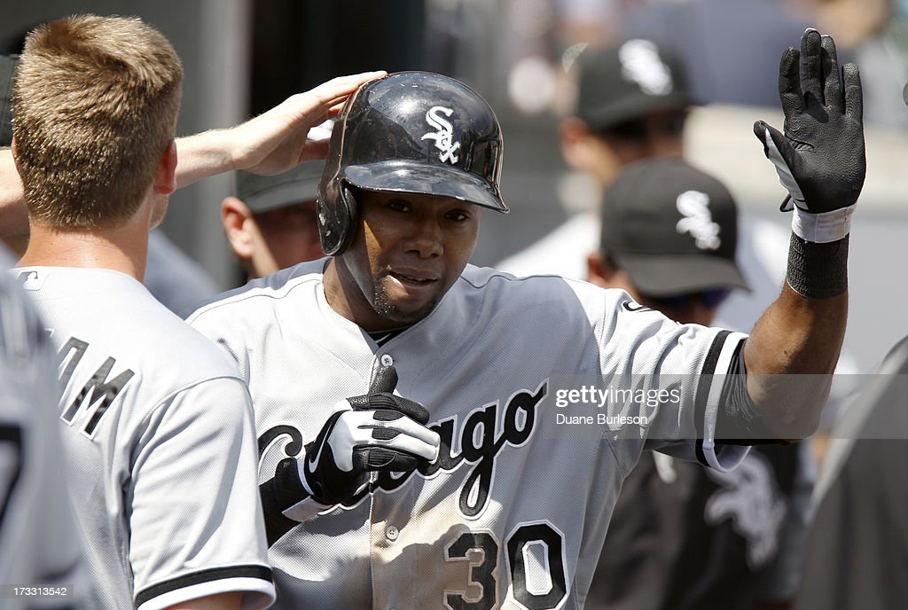 <a gi-track='captionPersonalityLinkClicked' href=/galleries/search?phrase=Alejandro+De+Aza&family=editorial&specificpeople=4181650 ng-click='$event.stopPropagation()'>Alejandro De Aza</a> #30 of the Chicago White Sox is congratulated in the dugout after hitting a solo home run against the Detroit Tigers in the eighth inning at Comerica Park on July 11, 2013 in Detroit, Michigan. The White Sox defeated the Tigers 6-3.