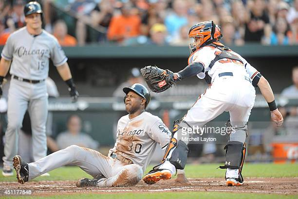 Alejandro De Aza of the Chicago White Sox is tagged out by Caleb Joseph of the Baltimore Orioles at the plate on a double steal in the second inning...