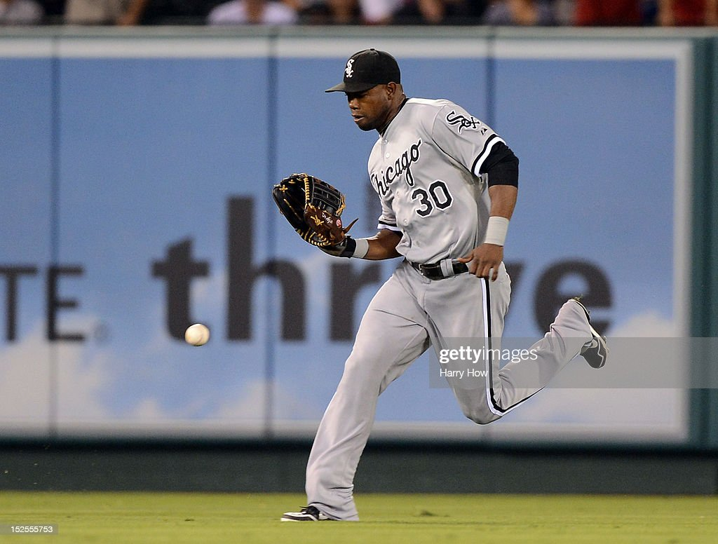 <a gi-track='captionPersonalityLinkClicked' href=/galleries/search?phrase=Alejandro+De+Aza&family=editorial&specificpeople=4181650 ng-click='$event.stopPropagation()'>Alejandro De Aza</a> #30 of the Chicago White Sox juggles a Albert Pujols #5 of the Los Angeles Angels single scoring two runs during the third inning at Angel Stadium of Anaheim on September 21, 2012 in Anaheim, California.