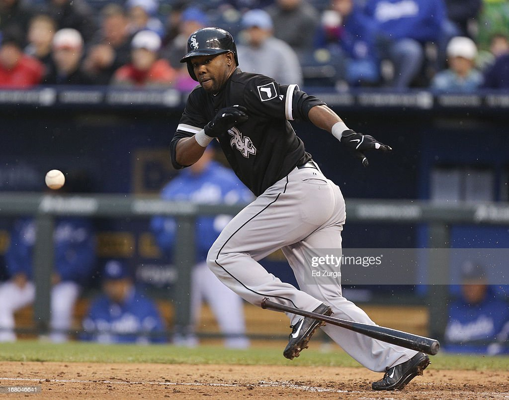 <a gi-track='captionPersonalityLinkClicked' href=/galleries/search?phrase=Alejandro+De+Aza&family=editorial&specificpeople=4181650 ng-click='$event.stopPropagation()'>Alejandro De Aza</a> #30 of the Chicago White Sox lays down a bunt against the Kansas City Royals in the sixth inning at Kauffman Stadium on May 4, 2013 in Kansas City, Missouri. De Aza was thrown out on the play.