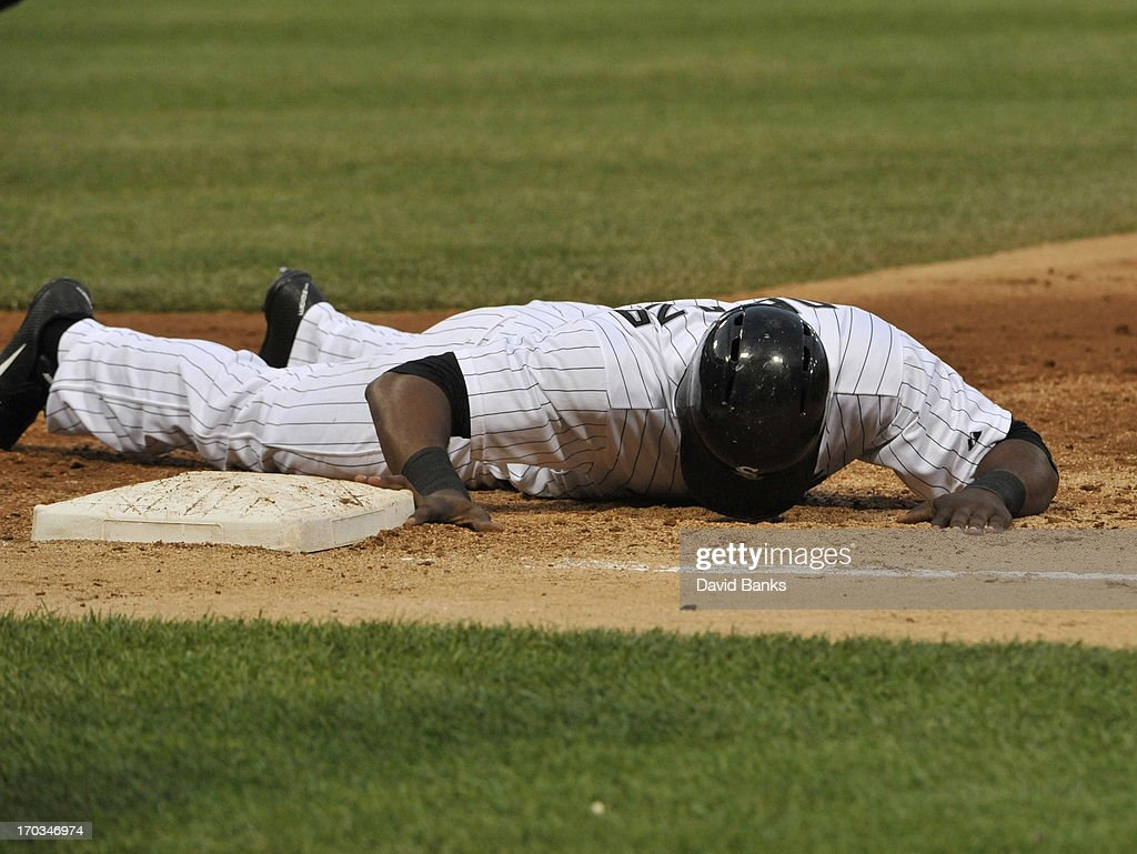 Alejandro De Aza #30 of the Chicago White Sox lies on the ground after being picked off of first base during the third inning against the Toronto Blue Jays on June 11, 2013 at U.S. Cellular Field in Chicago, Illinois.
