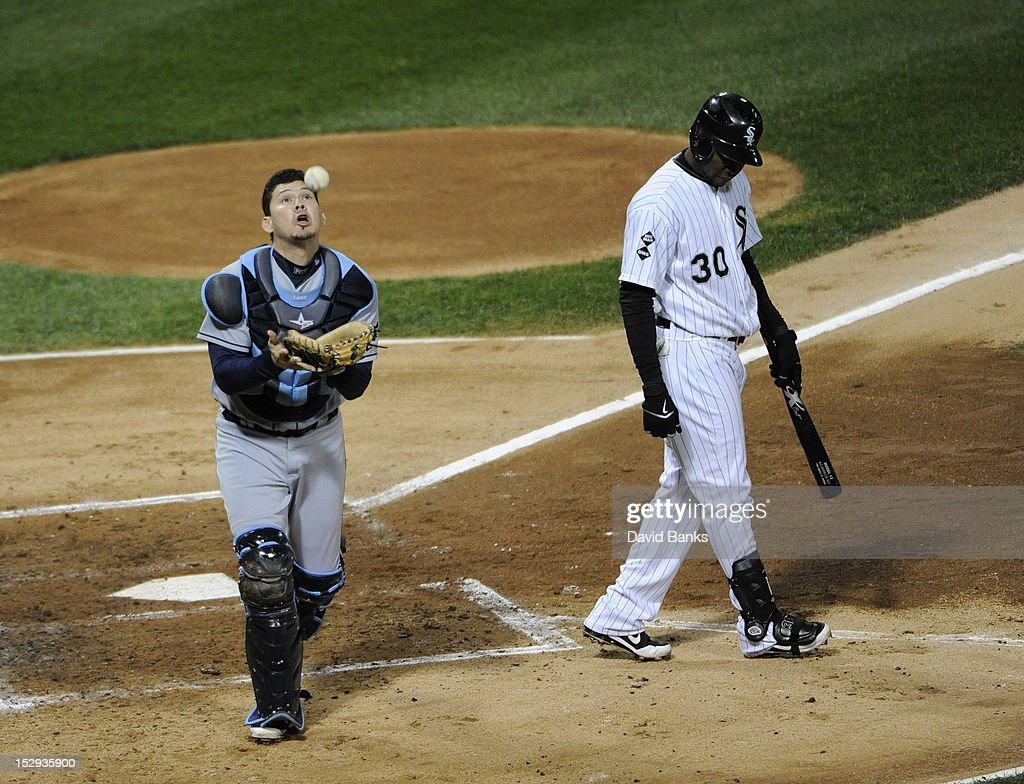 <a gi-track='captionPersonalityLinkClicked' href=/galleries/search?phrase=Alejandro+De+Aza&family=editorial&specificpeople=4181650 ng-click='$event.stopPropagation()'>Alejandro De Aza</a> #30 of the Chicago White Sox pops up a bunt attempt as Jose Lobaton #21 of the Tampa Bay Rays makes the catch in the third inning on September 28, 2012 at U.S. Cellular Field in Chicago, Illinois.