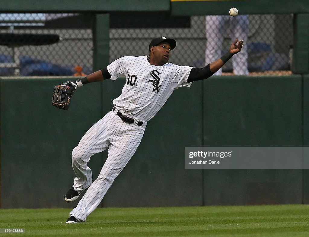 <a gi-track='captionPersonalityLinkClicked' href=/galleries/search?phrase=Alejandro+De+Aza&family=editorial&specificpeople=4181650 ng-click='$event.stopPropagation()'>Alejandro De Aza</a> #30 of the Chicago White Sox reaches for a ball hit by Omar Infante of the Detroit Tigers in the 2nd inning at U.S. Cellular Field on August 13, 2013 in Chicago, Illinois.
