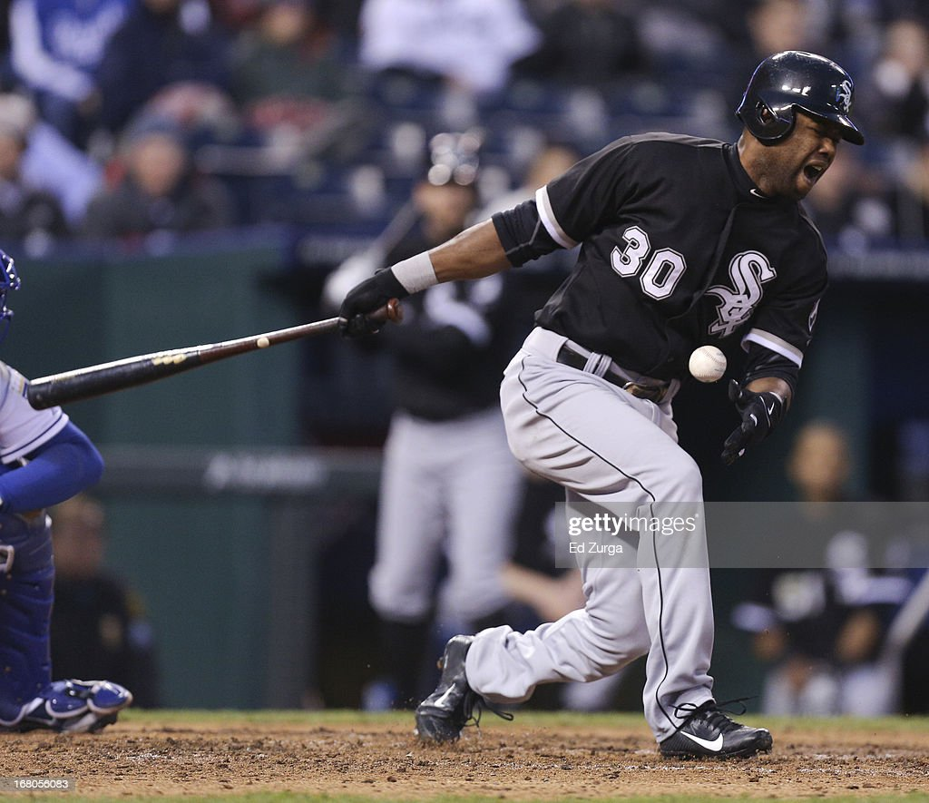 <a gi-track='captionPersonalityLinkClicked' href=/galleries/search?phrase=Alejandro+De+Aza&family=editorial&specificpeople=4181650 ng-click='$event.stopPropagation()'>Alejandro De Aza</a> #30 of the Chicago White Sox reacts after fouling a ball off his foot against the Kansas City Royals in the eighth inning at Kauffman Stadium on May 4, 2013 in Kansas City, Missouri.