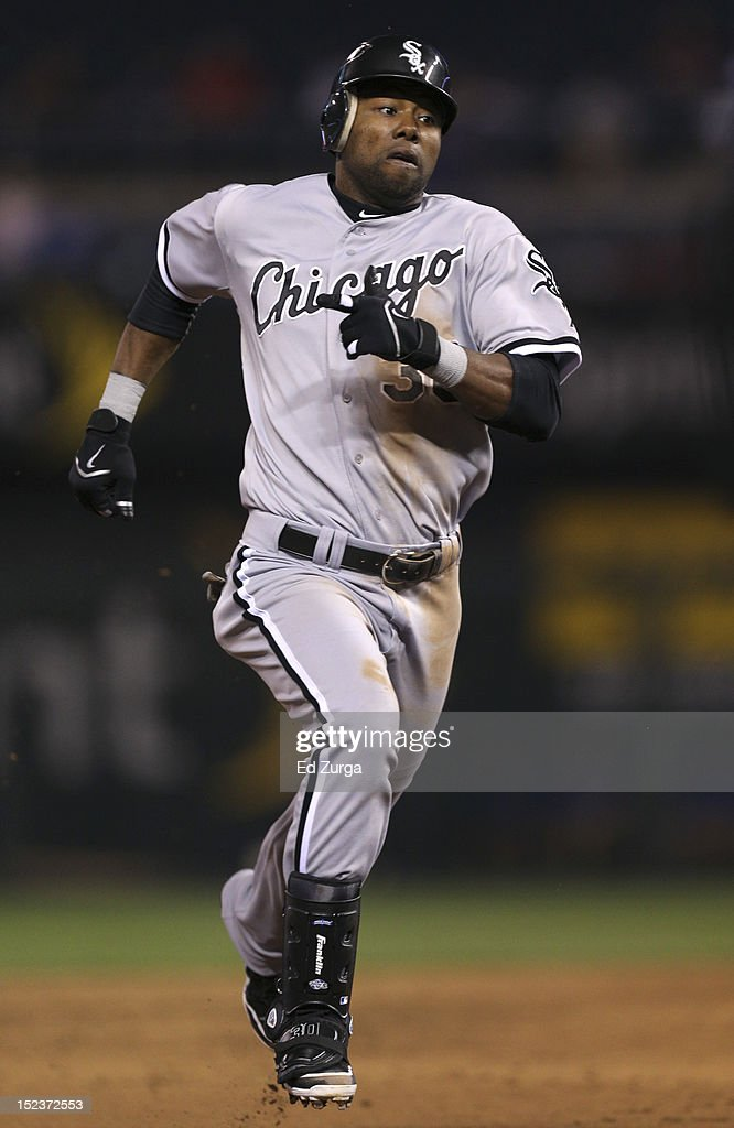 <a gi-track='captionPersonalityLinkClicked' href=/galleries/search?phrase=Alejandro+De+Aza&family=editorial&specificpeople=4181650 ng-click='$event.stopPropagation()'>Alejandro De Aza</a> #30 of the Chicago White Sox runs to third after hitting a triple against the Kansas City Royals in the third inning at Kauffman Stadium on September 19, 2012 in Kansas City, Missouri.