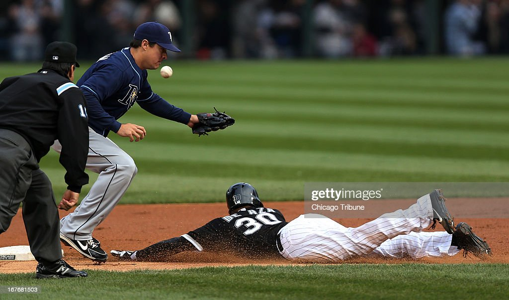 Alejandro De Aza (30) of the Chicago White Sox steals second base as Tampa Bay Rays second baseman Kelly Johnson can't handle the throw in the first inning at U.S. Cellular Field in Chicago, Illinois, on Saturday, April 27, 2013.