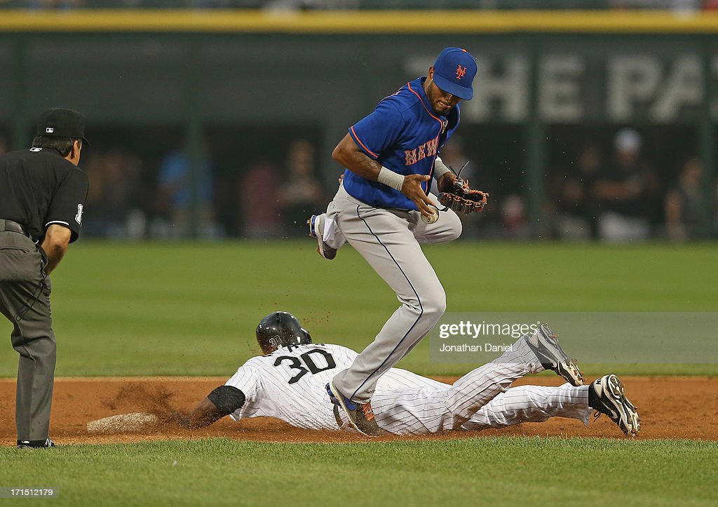 <a gi-track='captionPersonalityLinkClicked' href=/galleries/search?phrase=Alejandro+De+Aza&family=editorial&specificpeople=4181650 ng-click='$event.stopPropagation()'>Alejandro De Aza</a> #30 of the Chicago White Sox steals second base as Jordany Valdespin #1`of the New York Mets drops the ball in the 1st inning at U.S. Cellular Field on June 25, 2013 in Chicago, Illinois.