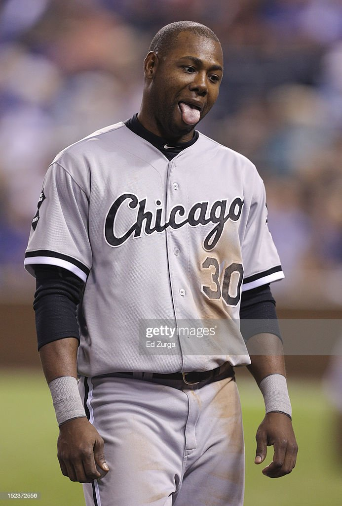 <a gi-track='captionPersonalityLinkClicked' href=/galleries/search?phrase=Alejandro+De+Aza&family=editorial&specificpeople=4181650 ng-click='$event.stopPropagation()'>Alejandro De Aza</a> #30 of the Chicago White Sox sticks out his tongue as he walks to the dugout against the Kansas City Royals in the third inning at Kauffman Stadium on September 19, 2012 in Kansas City, Missouri.