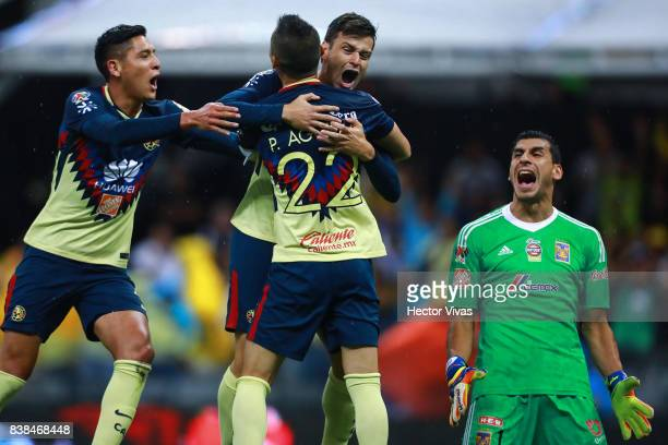 Alejandro Diaz of America celebrates with teammates after scoring the second goal of his team during the 6th round match between America and Tigres...