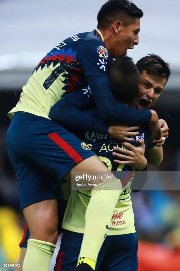 Alejandro Diaz of America celebrates with teammates after scoring the second goal of his team during the 6th round match between America and Tigres UANL as part of the Torneo Apertura 2017 Liga MX at Azteca Stadium on August 23, 2017 in Mexico City, Mexico.