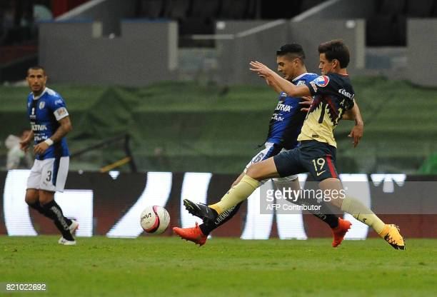 Alejandro Diaz of America vies for the ball with Javier Guemez of Queretaro during their Mexican Apertura Tournament 2017 football match at the...