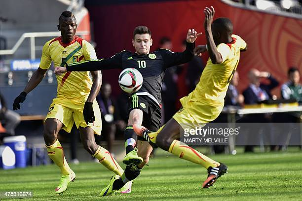 Alejandro Diaz of Mexico makes a pass past Hamidou Maiga of Mali in defense during FIFA's Under20 World Cup's football match between Mexico and Mali...