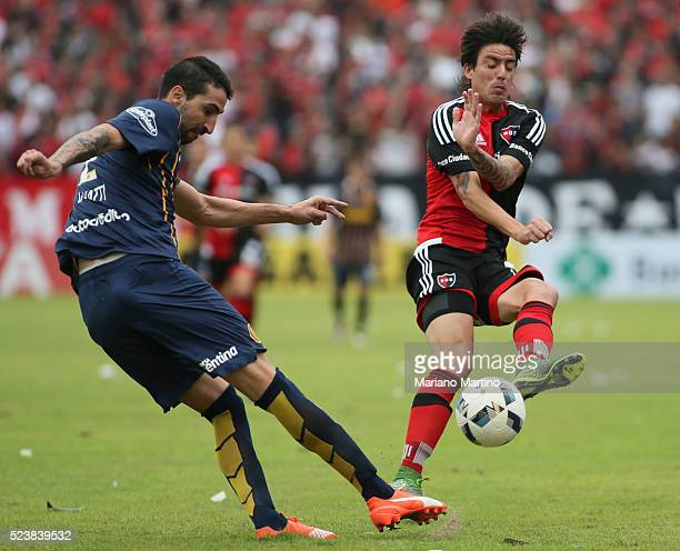 Alejandro Donati of Central fights for the ball with Mauro Formica of Newell's during a match between Newell's Old Boys and Rosario Central as part...