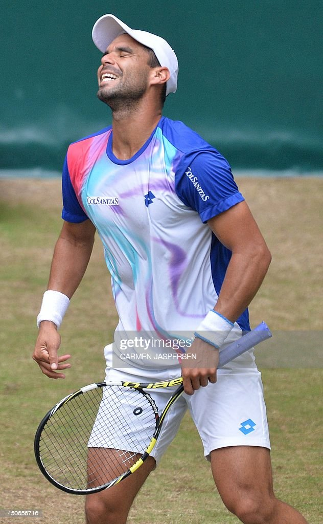 <a gi-track='captionPersonalityLinkClicked' href=/galleries/search?phrase=Alejandro+Falla&family=editorial&specificpeople=553827 ng-click='$event.stopPropagation()'>Alejandro Falla</a> from Columbia reacts during his final match against Swiss tennis player Roger Federer at the ATP Gerry Weber Open tennis tournament in Halle, western Germany on June 15, 2014. JASPERSEN