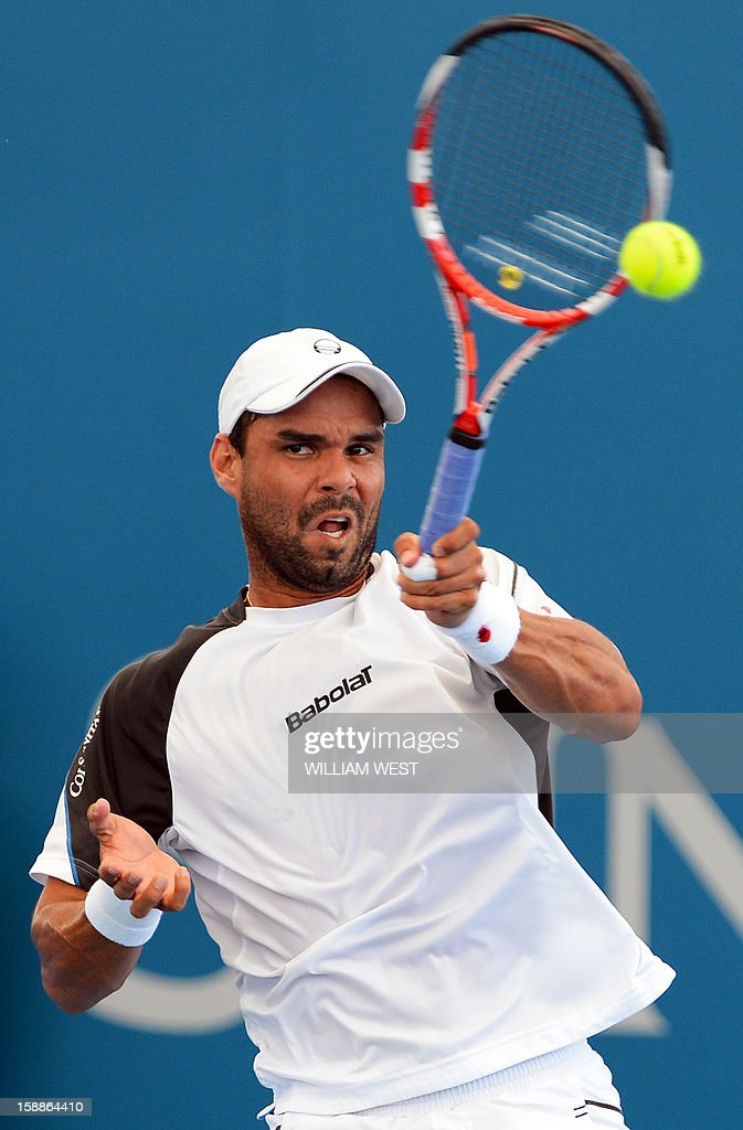 Alejandro Falla of Colombia hits a forehand return during his match against Gilles Simon of France in the second round at the Brisbane International tennis tournament on January 2, 2013. AFP PHOTO/William WEST IMAGE RESTRICTED TO EDITORIAL USE - STRICTLY NO COMMERCIAL USE