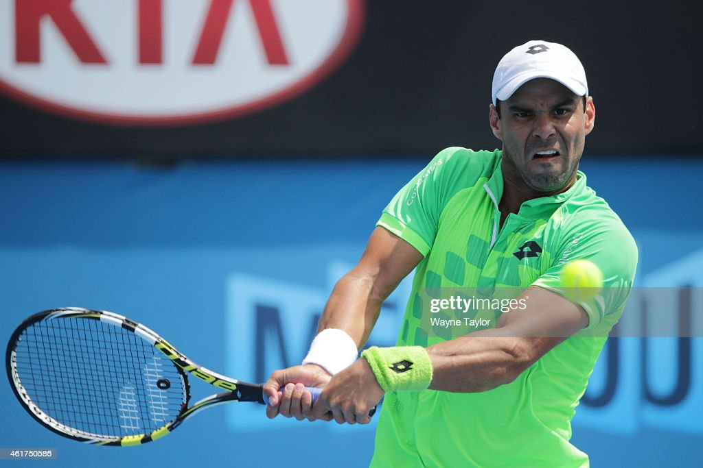 <a gi-track='captionPersonalityLinkClicked' href=/galleries/search?phrase=Alejandro+Falla&family=editorial&specificpeople=553827 ng-click='$event.stopPropagation()'>Alejandro Falla</a> of Colombia plays a backhand in his first round match against Tomas Berdych of the Czech Republic during day one of the 2015 Australian Open at Melbourne Park on January 19, 2015 in Melbourne, Australia.